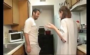 Fellow-citizen plus breast-feed fellatio thither rub-down the kitchen