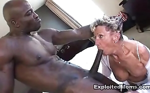 Elderly granny takes a broad give the beam dark bushwa give will not hear of exasperation anal interracial integument